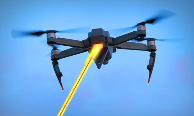 UAV with stun gun and laser emitter