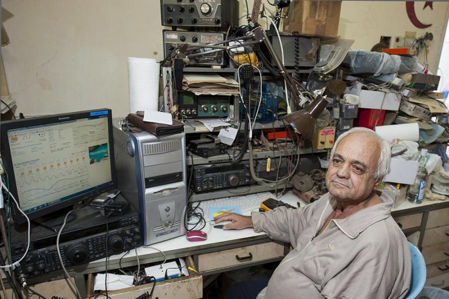 Mustafa, 1B1AD, in Lefkosa, Northern Cyprus. His radio shack is a collection of old and new.
