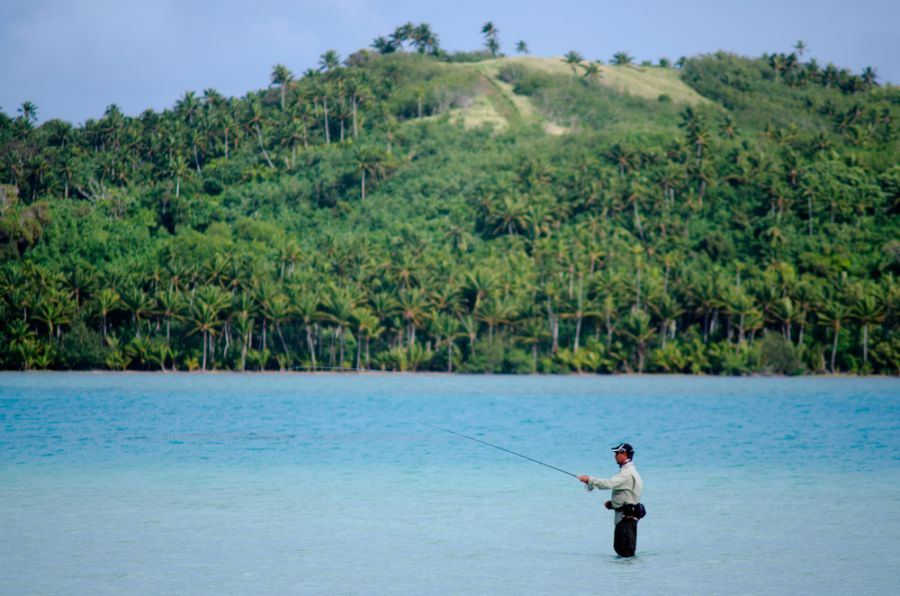 Aitutaki Island E51WET Tourist attractions spot Fisherman casting for bonefish.