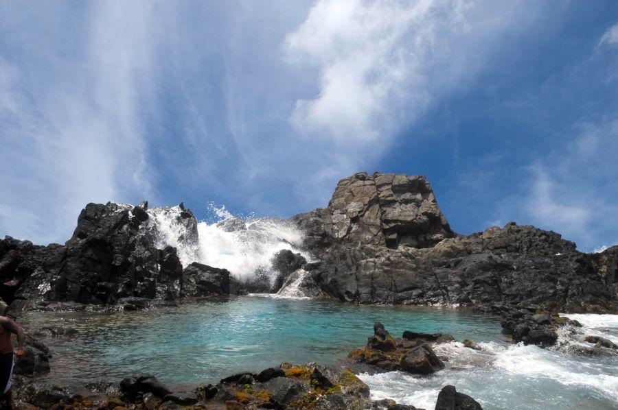 Aruba P40BC Waves crashing over the rocks surrounding the Natural Pool in Aruba