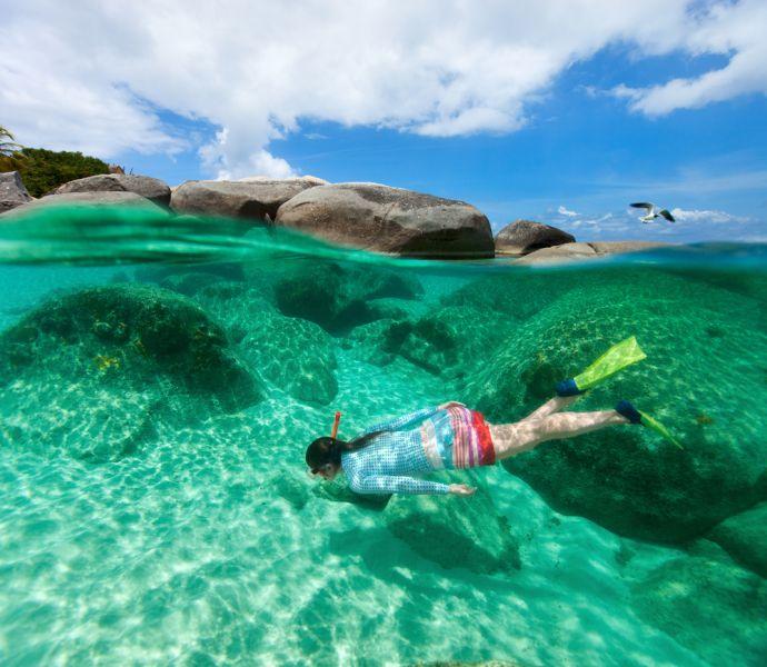 British Virgin Islands VP2VVV Tourist attractions spot Split photo of young woman snorkeling