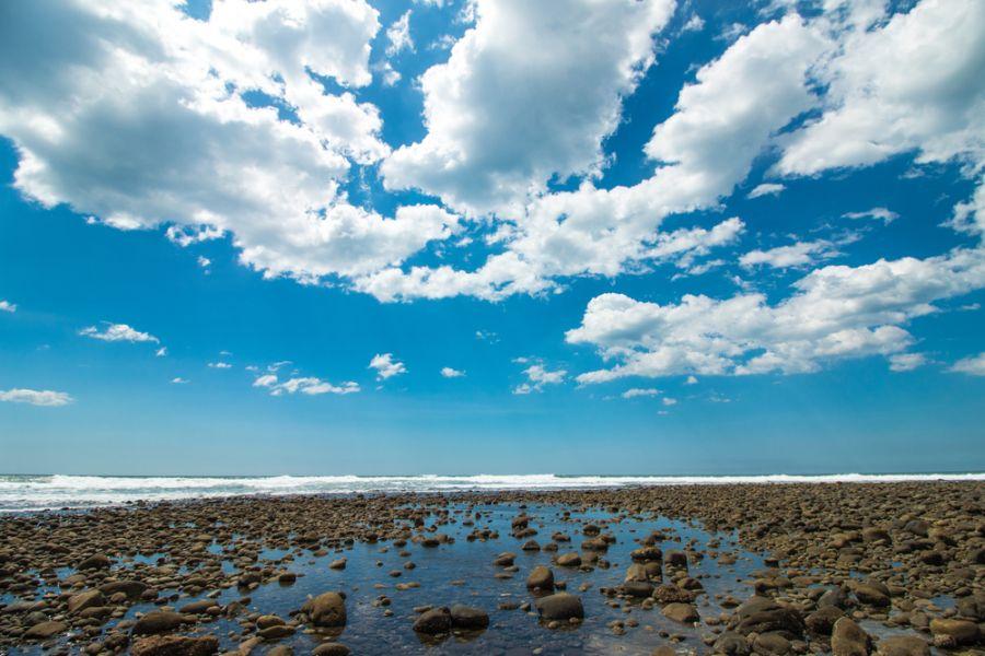 El Salvador YS90IARU Tourist attractions spot Volcanic beach at Playa El Tunco.
