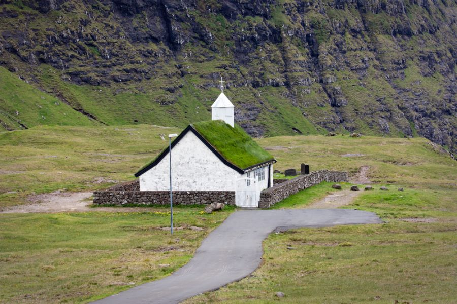 Faroe Islands OY/LA4OFA Saksun, remote church in a green valley surrounded by high mountains