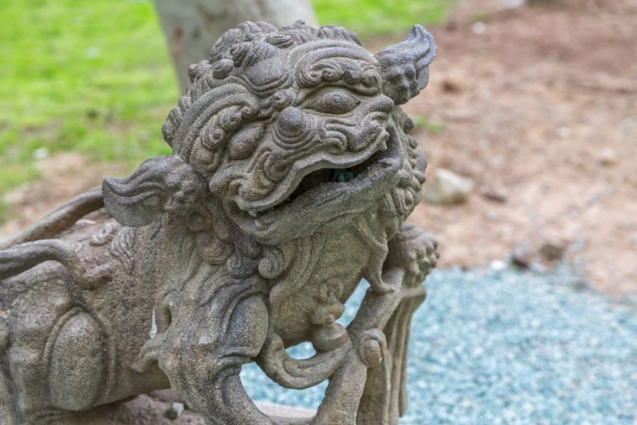 Iran EP2A Tourist attractions spot Stone dragon smiling face in park. Tehran in Iran