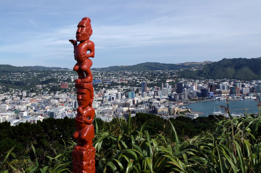 New Zealand An ancient Maori sculpture of man and a woman mad out of wood on top of Mt victoria in Wellington, New Zealand.