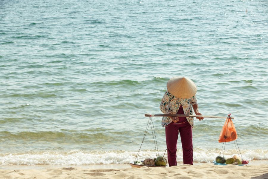 Phu Quoc Island 3W4VE 3W4VX Tourist attractions spot Fruit vendor on the beach of Phu Quoc Island, popular tourist destination, Southern Vietnam.