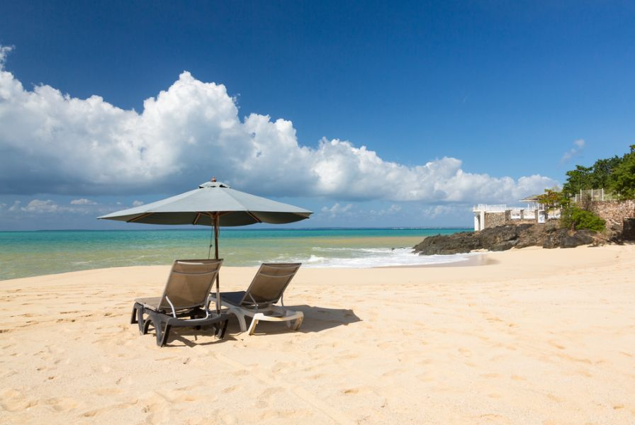 Saint Martin Island FS/DL9USA Reclining beach loungers and umbrella on Baie Rouge.