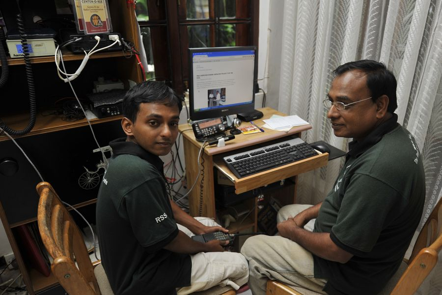 Sri Lanka 4S6YRW 4S6WAS Reshan, 4S6YRW, on the left, holds a 144 MHz handheld transceiver.