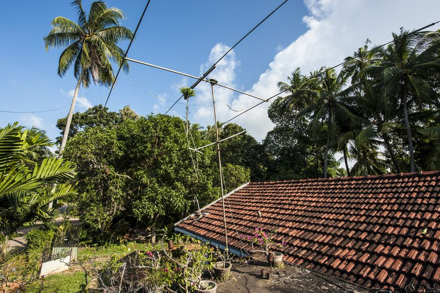 Sri Lanka 4S7NE Antennas of 4S7NE are home-made, one directional Yagi and assorted wires among the trees.