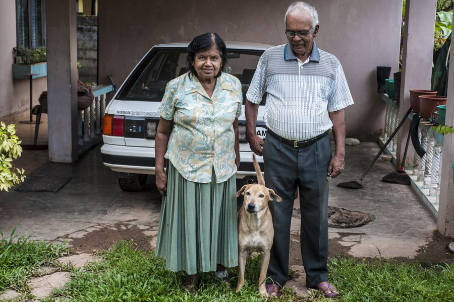 4S7NE Sri Lanka The family picture — Nelson's wife, one of the dogs in the middle, and Nelson himself on the right.