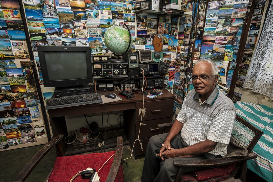 Sri Lanka 4S7NE QSLs All walls of Nelson's radio shack are decorated with colourful QSL cards