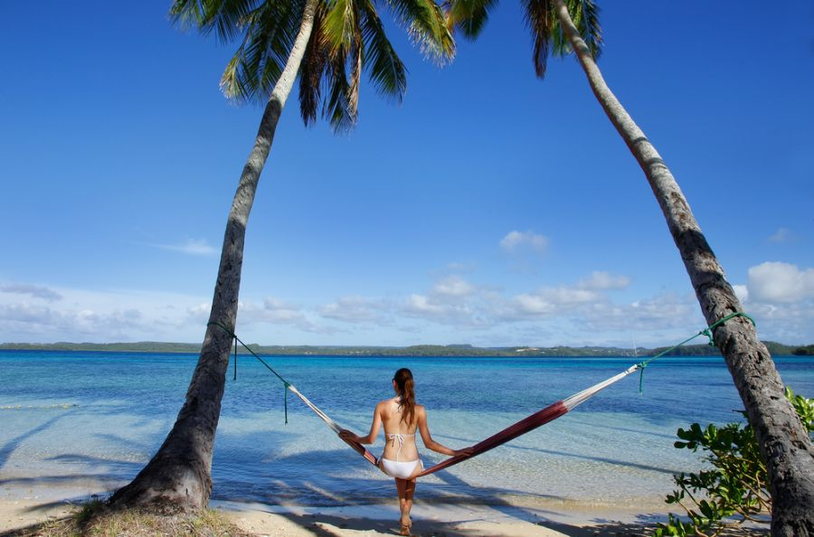 Vava�u Islands A35JP/P DX News Young woman in bikini sitting in a hammock between palm trees