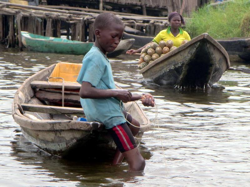 Benin TY5AA Tourist attractions spot Pineapple vendor, Ganvie village, Lake Nokoue near Cotonou.