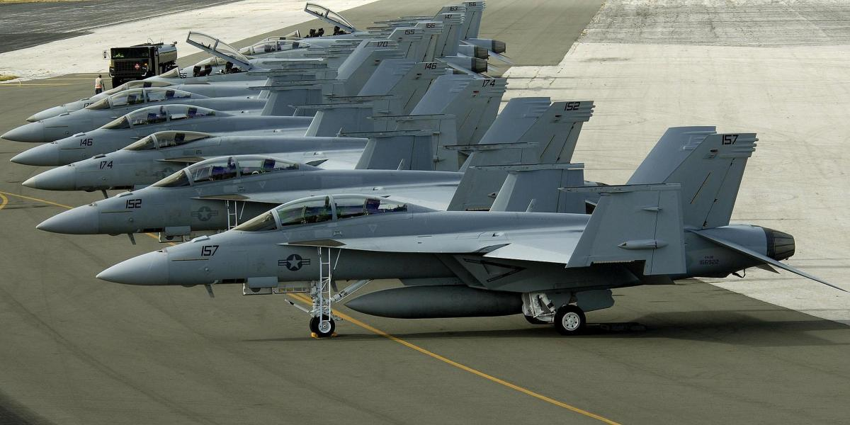 KH9/N7NVK A group of U.S. Navy F-18 ''Hornets'' parked on Wake Island's flight line. Attractions.