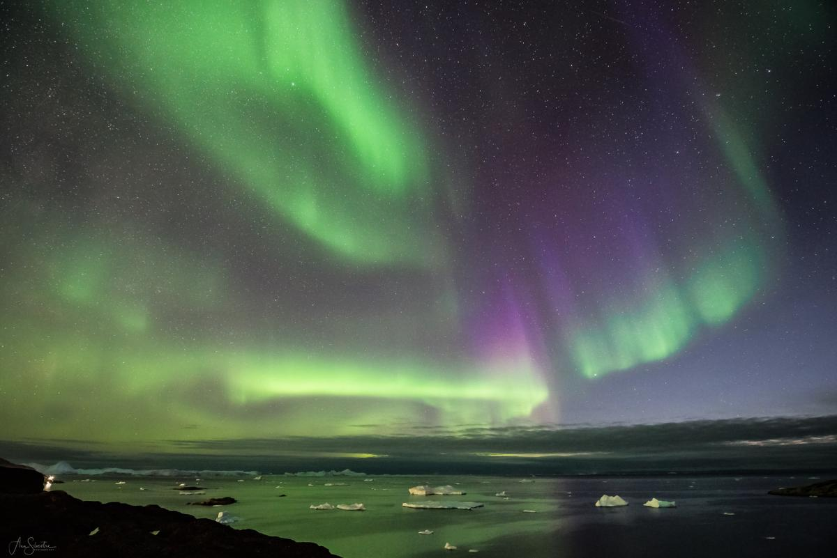 OX3LX Aurora above Disco Bay or Qeqertarsuup tunua, on the western coast of Greenland. Tourist attractions spot