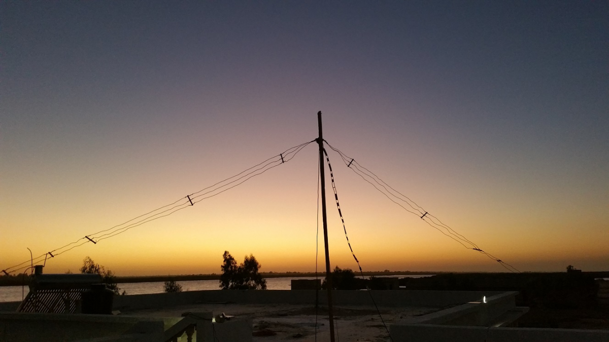 6W1/WA3DX Alpha Delta DX - EE Dipole Antenna at sunset on Marjoj Island