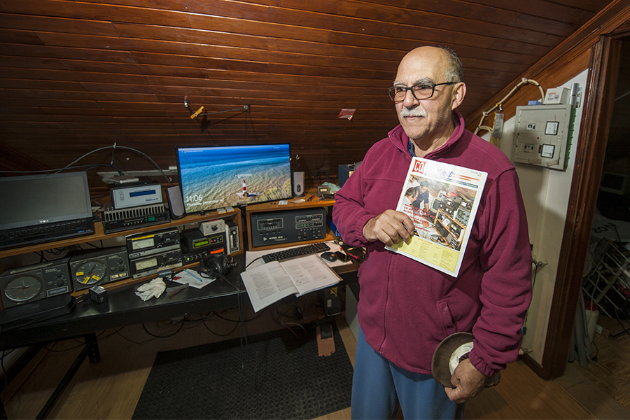 Inside the radio shack of CT1DVV. Antonio shows the CQ Contest magazine with a cover photograph