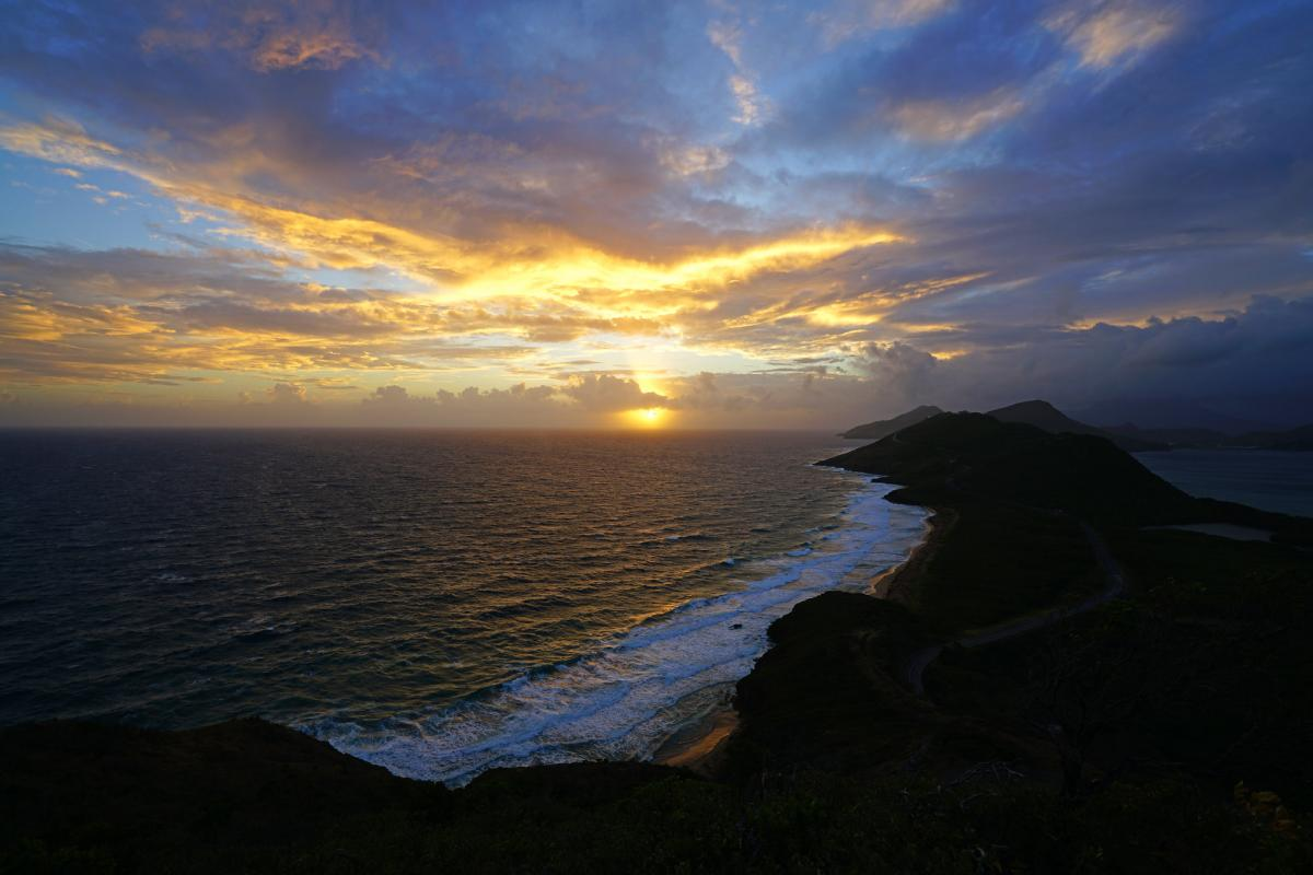 Magnificent sunrise over the islands Saint Kitts and Nevis. DX News V49V